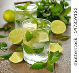 mojito cocktail on a brown table | Shutterstock . vector #147359132