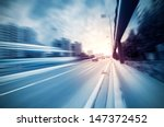 highway heading to the city in... | Shutterstock . vector #147372452