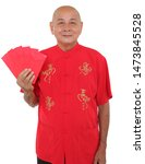 "Small photo of Asian senior man dress in cheongsam with Chinese calligraphy ""Achieve Immediate Success"" and ""Good Luck"". Hands holding red packets / ang pow."
