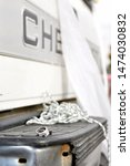 Black and white.  Close-up of wedding rings, on the bumper of a Chevy truck. Truck decorated with toilet paper.