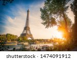 Sunset View Of Eiffel Tower An...