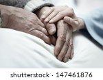 hand of woman touching senior