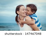 portrait of happy mother and... | Shutterstock . vector #147467048