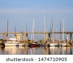 Row Of Yachts In Urban Marina...
