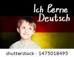 Thinking child boy student against the Germany flag background. Deutsch concept with inscription learn Deutsch on Deutsch language