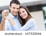 new home owners with key | Shutterstock . vector #147520046