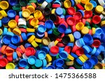 Small photo of Plastic bottle caps background. Cap material is recyclable.Remove lids from plastic bottles before recycling them. Recycling collection and processing plastic bottle caps