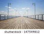 Old Wooden Pier Over The Sea...