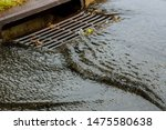Water Gushing From Storm Sewer...