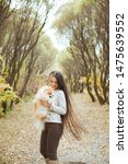 Stock photo charming young woman with little spitz dog in autumn park 1475639552
