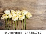 pastel roses on wooden... | Shutterstock . vector #147581762