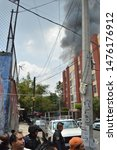 Small photo of Mexico city / Mexico- August 11, 2019: A strong fire is recorded in streets of Basalto and Cantera, Pedregal de Santo Domingo, Mexico City; Firefighters and police work to quell the fire.