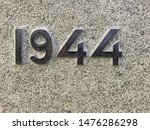 The year 1944 chiselled out of stone and polished