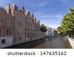River channel and buildings in Bruges, Belgium  - stock photo