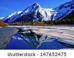 a partially frozen lake with... | Shutterstock . vector #147652475