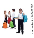 Happy friends reunite in school after the long summer vacation  - isolated - stock photo