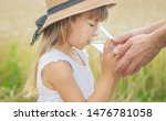 the father gives the child... | Shutterstock . vector #1476781058