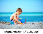 Cute Kid Playing On The Sea...