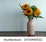 A Pink Vase Of Sun Flowers On ...