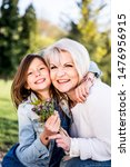 Small photo of Grandmother with granddaughter playing in a park