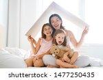 mother and children girls in...   Shutterstock . vector #1477250435