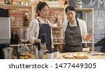 Small photo of lady barista learning on first day on new job in cafe bar. angry young woman manager in restaurant scold at employee with make wrong order and telling to redo it again. waitress argue with boss