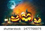 Small photo of Halloween pumpkin head jack lantern with burning candles in scary deep night forest