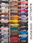 Stock photo stand with many cloth espadrilles of different colors in a small shop in spain 1477730978