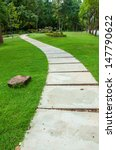 walkway on green grassy in park. | Shutterstock . vector #147790622