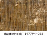 the wall is made of yellow dry... | Shutterstock . vector #1477944038