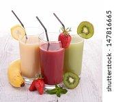 fruit juice on wood | Shutterstock . vector #147816665