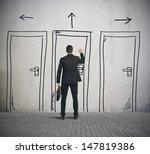 Businessman Opens A Door...
