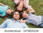 sleeping family lying on the... | Shutterstock . vector #147820256