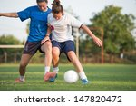 two female soccer players on... | Shutterstock . vector #147820472