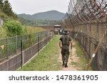 South Korean Soldier Patrols...