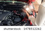 Small photo of Man inspection holding Battery Capacity Tester Voltmeter.for service maintenance of industrial to engine repair.In Factory transport automobile automotive image