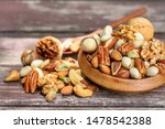 Mix Nuts In Wooden Plate On...