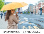 A Girl With A Yellow Umbrella...