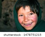 Small photo of Bamyan (Bamiyan) / Central Afghanistan - 19 Aug 2005: This poor girl lives in the caves in Bamyan (Bamiyan), Afghanistan. A cave dweller in the cliffs near to the Bamyan (Bamiyan) Buddhas, Afghanistan