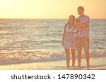 family resting on the sea... | Shutterstock . vector #147890342