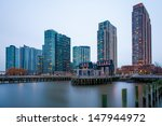 the buildings of long island in front of east river - stock photo