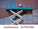builder on a scissor lift... | Shutterstock . vector #147951986