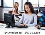 Teenage Girl Using Computer At...