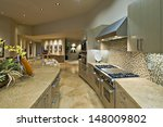 Stock photo open plan kitchen with living room in modern house 148009802