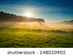 photo of sunrise over misty... | Shutterstock . vector #148020902
