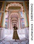 Small photo of Young asian woman posing at Patrika gate. The ninth gate of Jaipur, Jaipur, Rajasthan, India