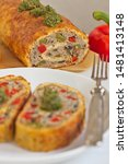 Small photo of cheese roulade with minced meat, colored paprika and mushrooms. Ketogenic diet.