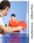 Small photo of Table tennis game. Two young people playing table tennis