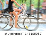 Zoom blurred bikes in profile - stock photo