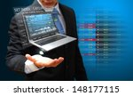 laptop with graph report for... | Shutterstock . vector #148177115